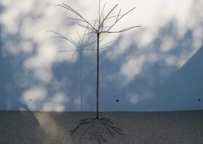 Tall bird feed with tree like top and base